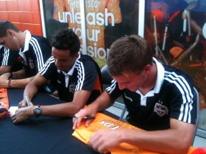 Colin Rolfe and Calen Carr sign autographs at the Dynamo Team Store Grand Opening